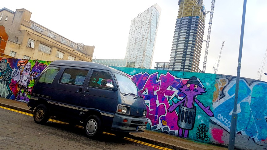 Van with Buildings